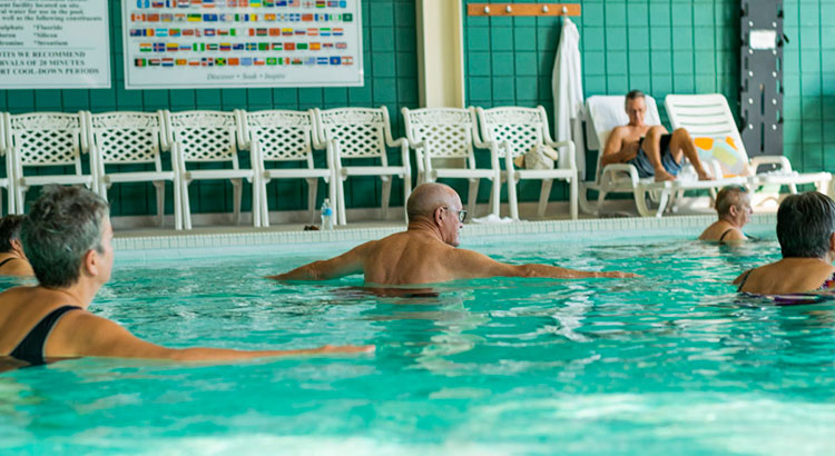 Seniors doing aquatic exercise in the Temple Gardens Hotel & Spa pool