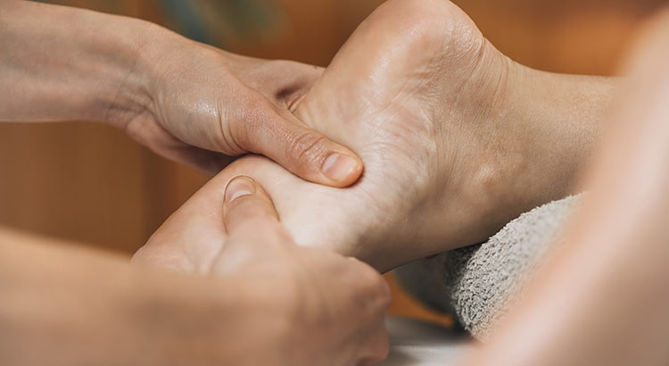 person getting a reflexology treatment